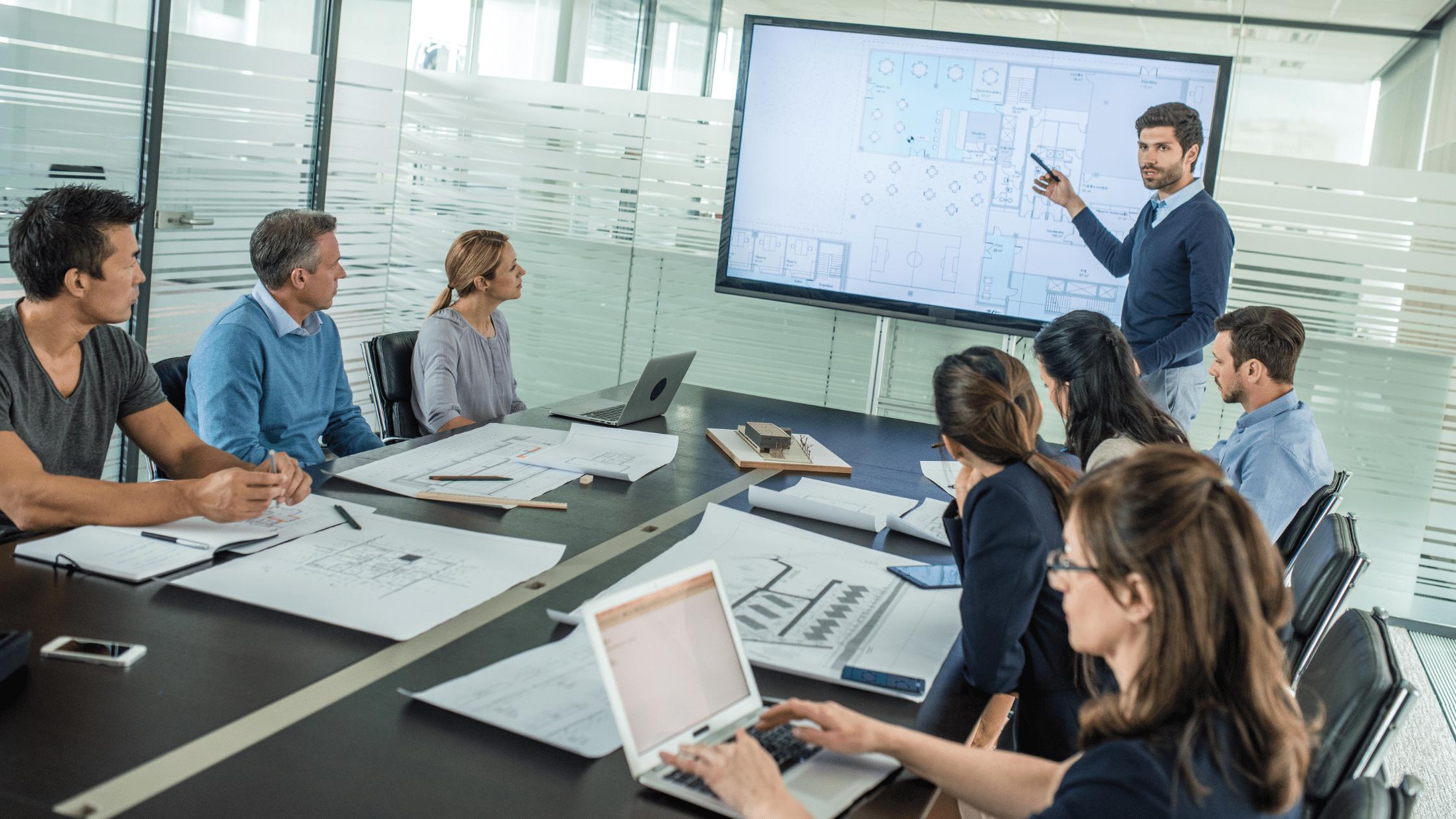 photo of a team meeting using equipment installed through an av system design
