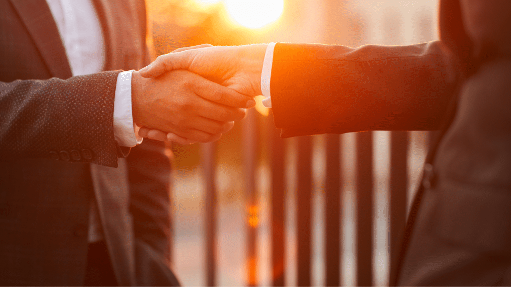 photo of two people shaking hands and showing the power of connection through av integration