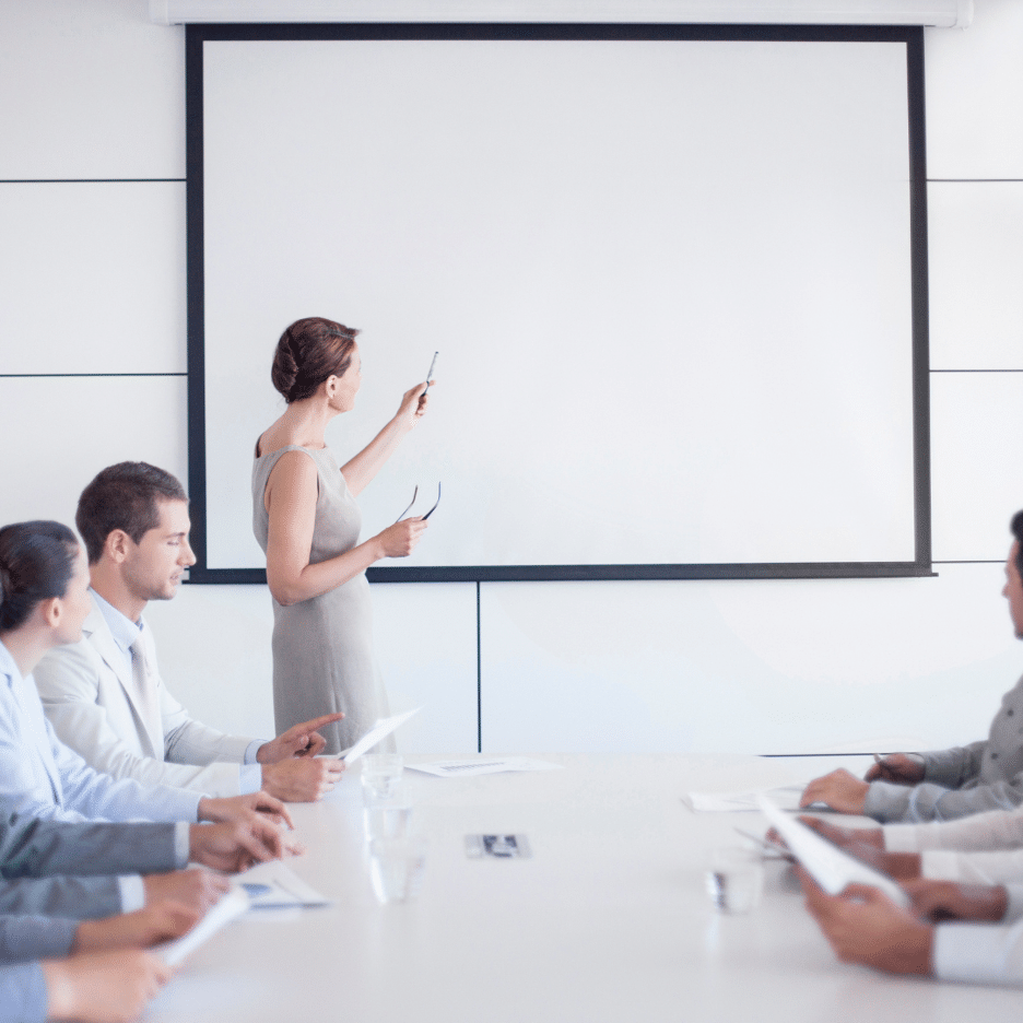 photo of woman presenting to colleagues why applied global technologies works